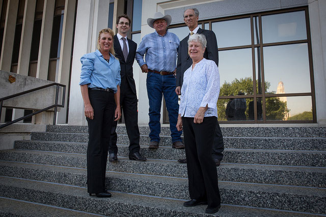 Susan Luebbe (left), Susan Dunavan, and Randy Thompson (center), plaintiffs in the Thompson v. Heineman lawsuit, stand together with their attorneys, Brian Jorde (left) and David Domina, on the steps of the Lancaster County Courthouse. Sept. 27, 2013. Photo by Mary Anne Andrei / Bold Nebraska.