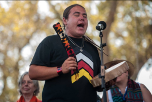 Greg Grey Cloud sings onstage at the Harvest the Hope #NO KXL benefit concert on Sept. 27, 2014.