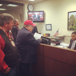Cowboy Indian Alliance members Art Tanderup and Rosebud Sioux Tribe President Cyril Scott visit Sen. Mary Landrieu's office on Nov. 18, 2014.