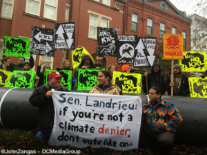 Cowboy Indian Alliance members Art Tanderup, Greg Grey Cloud and Aldo Seoane at Monday's protest outside Sen. Landrieu's house. (Photo by