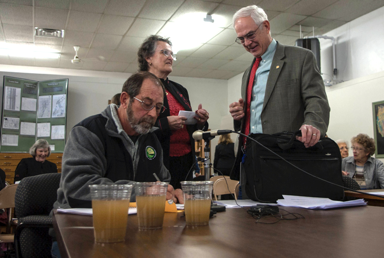 "Sen. Ken Haar speaks with a local activist at the March 24 NOGCC hearing, where another citizen poured the glasses of ""fracked water"" on the table for Commissioners (as seen in this video viewed 1.8 million times on YouTube). Photo: Mark Hefflinger"