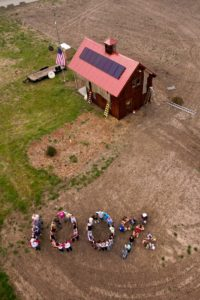 Pipeline fighters form a Human 100% Message by the Clean Energy Barn along the rejected Keystone XL pipeline route calling for 100% clean energy for all. (Photo by Matt Michaelsen / Spectral Q)
