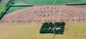 Nebraska farmers in Keystone XL battle carve a massive crop art message into an 80-acre cornfield calling for 100% clean energy for all. (Photo by Tom Simmons / Spectral Q)