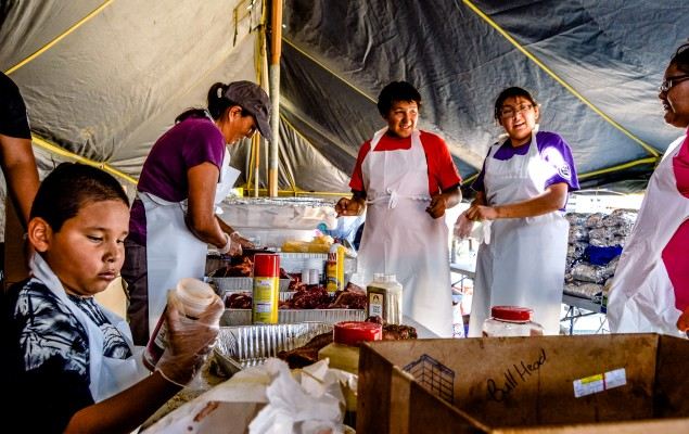 Folks from southern Standing Rock preparing a meal for 6,000 people on 3 September 2016. Photo by Rob Wilson for Bold Alliance